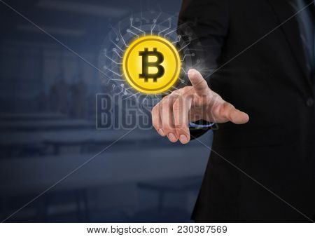 Digital composite of Businessperson touching bit coin graphic icon