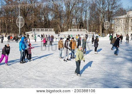 Saint Petersburg, Russia - March 04, 2018: Many People Visit The Open Skating Rink On Elagin Island