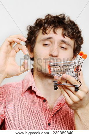 Curly-haired Guy With The Russian Ruble And The Small Cart From The Supermarket In Your Hands. Finan