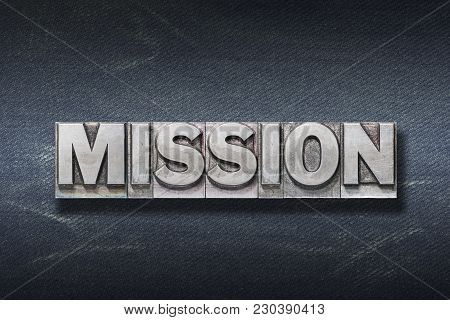 Mission Word Made From Metallic Letterpress On Dark Jeans Background