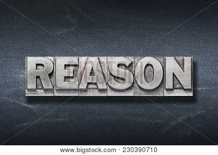 Reason Word Made From Metallic Letterpress On Dark Jeans Background
