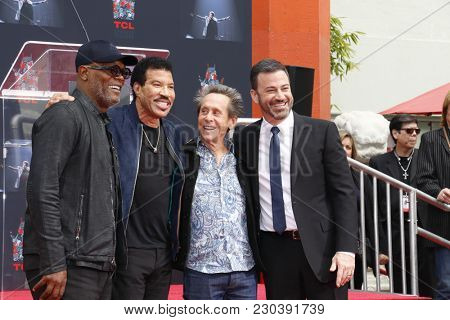 Samuel L. Jackson, Lionel Richie, Jimmy Kimmel and Brian Grazer at Lionel Richie Hand And Footprint Ceremony held at the TCL Chinese Theatre in Hollywood, USA on March 7, 2018.