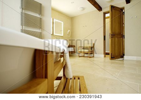Beautiful White Bath For An Open Door. Bath Stands In A Wooden Frame