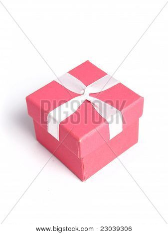 Pink gift box with a white bow