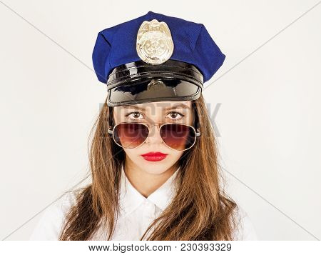 Portrait Of Long-haired Young Police Woman, Isolated On White Background