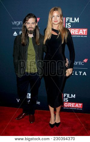 LOS ANGELES - MAR 2:  Tom Payne, Jennifer Akerman at the Film Is GREAT Reception Honoring British Oscar Nominees at the British Residence on March 2, 2018 in Los Angeles, CA
