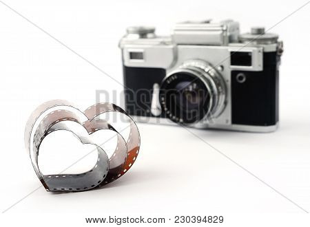 Film In The Form Of Heart On The Background Of Retro Film Camera