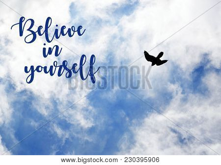 Believe In Yourself.motivation Inspirational Quote On Blue Sky With Clouds And Flying Bird Backgroun