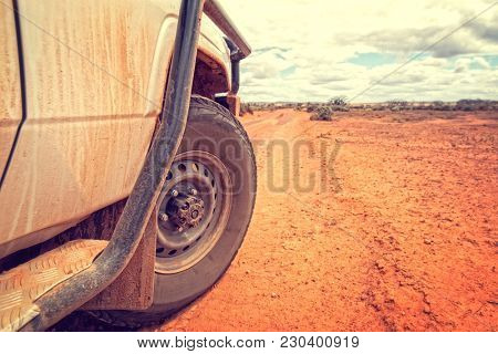 South Australia Outback desert with 4WD on track under cloudy sky