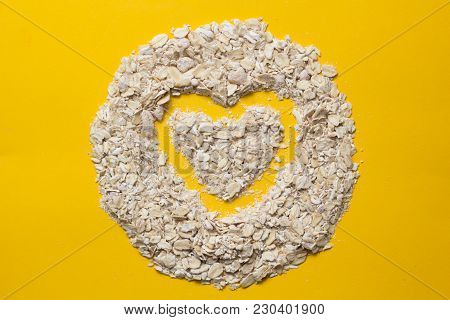 Oatmeal Flakes For Health. Vegetarian Food For Breakfast On A Colored Background. Organic Product. H