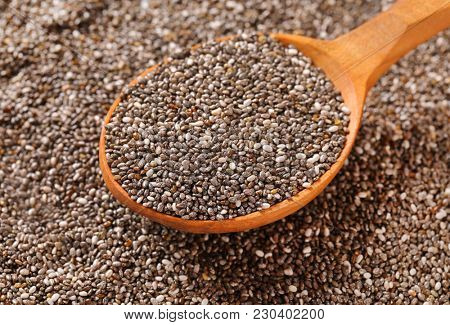 spoon of healthy chia seeds on chia seeds background
