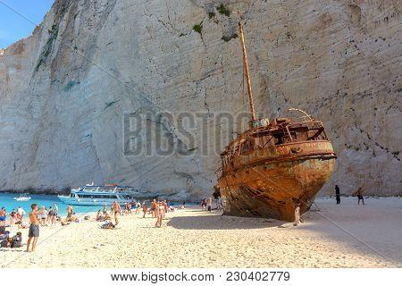 Zakynthos, Greece, September 27, 2017: Tourists Visit The Famous Navagio Shipwreck Beach In Zakyntho