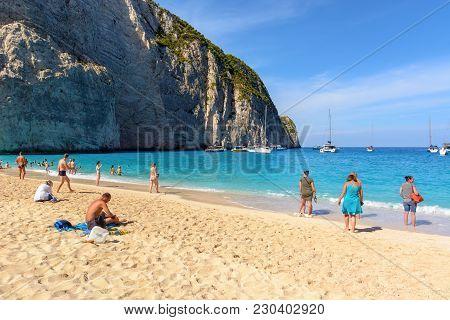 Zakynthos, Greece, September 27, 2017: Tourists Enjoying A Summer Day On Navagio Beach In Greece. Za