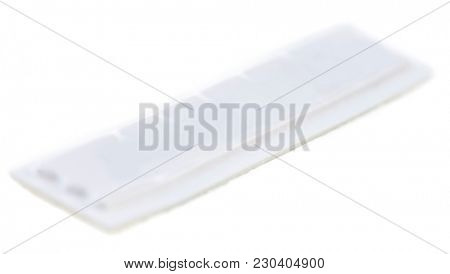 Security tag for theft protection isolated on white background.