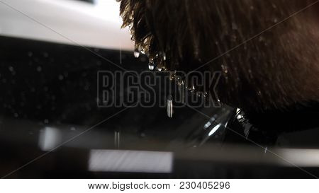 Close Up Of Man Getting Hair Washed In A Hair Salon, Water Drops Falling In Slow Motion. Barber Wash