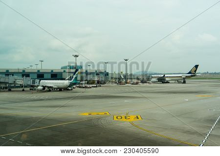 Singapore - January 6, 2018: Airplane Ready To Take Off At Changi International Airport. Departure H