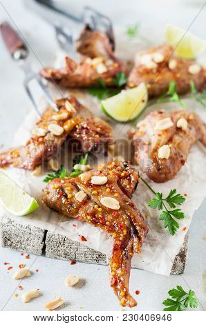 Asian Sticky Grilled Chicken Wings With Peanuts