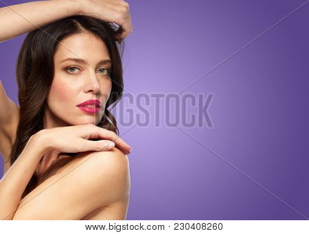 beauty, make up and people concept - close up of happy smiling young woman over ultra violet background