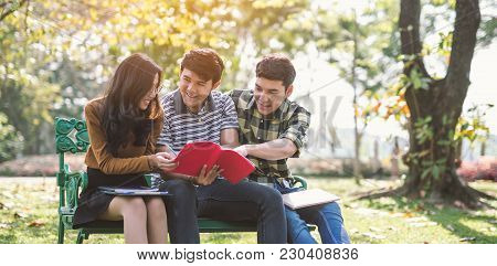 Young People Studying Reading Book In Park. Education Study By Read.