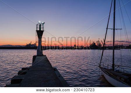 Lighthouse At Sunset In Port Burgas, Black Sea, Bulgaria.