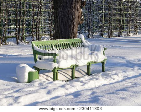 Snow-covered Bench In Summer Garden At Winter In Saint Petersburg, Russia.