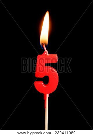 Burning Candle In The Form Of Five Figures (numbers, Dates) For Cake Isolated On Black Background. T