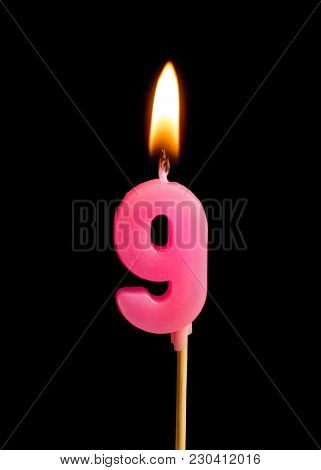 Burning Candle In The Form Of Nine Figures (numbers, Dates) For Cake Isolated On Black Background. T
