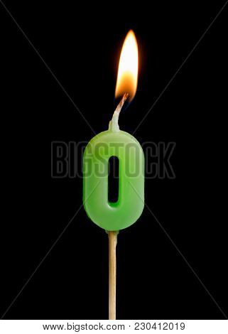 Burning Candle In The Form Of Zero Figures (numbers, Dates) For Cake Isolated On Black Background. T