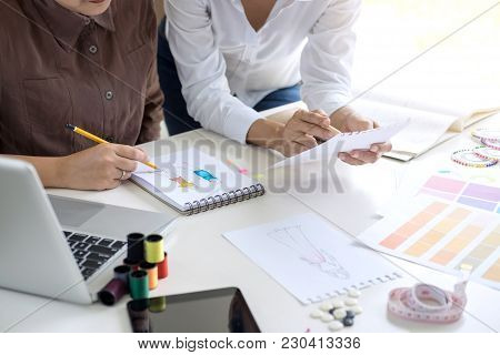 Two Professional Stylish Fashion Designer Working As Fashion Designers Measure As Sketches In Worksh