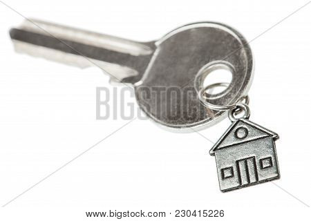 Key On A Charm With The House On A White Background, Nobody.