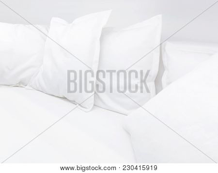 Few White Pillows On Bed. Clear White Bed Linen For Restful Sleep.