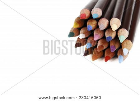 Stack Of Color Pencils With Space For Text, White Background. Closeup Of Texture Wood Colored Pencil