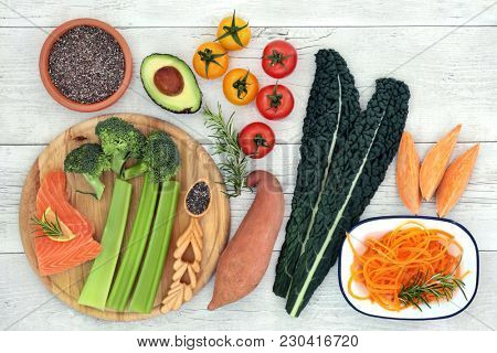 Health food concept to improve brain power and promote memory with fish, vegetables, fruit, seeds and herbs high in omega 3 fatty acids, antioxidants, vitamins, protein, anthocyanins and minerals.