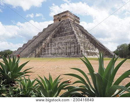 Pyramid And Agaves In Chichen Itza Mayan Town In Mexico, Ruins At Archaeological Sites Landscapes Wi