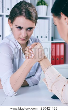 Two Female Office Wokers Armwrestling, Exerting Pressure On Each Other, Struggling For Leadership. B