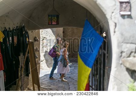 Sighisoara, Romania - 1 July 2016: Tourists Walking In The City Center Of Sighisoara, Romania