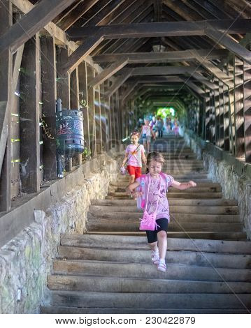 Sighisoara, Romania - 1 July 2016: Girls Running On The Scholars' Stairs, Built In 1642 In Sighisoar