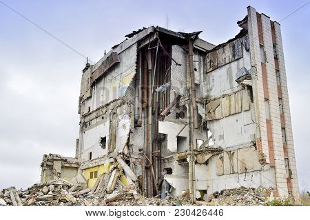 The Remains Of The Destroyed Industrial Building With Internal Kommunikatsiy. The Section Of The Bui