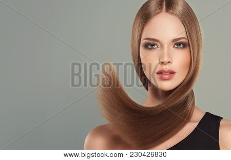 Beautiful Model Girl With Shiny Brown And Straight Long  Hair . Keratin  Straightening . Treatment,