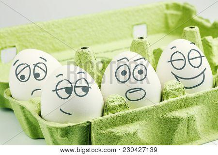 Four Eggs In Eggbox. Types Of Temperaments. Sanguine, Choleric, Phlegmatic And Melancholic.