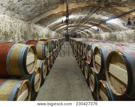 Bordeaux , France - May 10 , 2017 : Wines Fermenting In Traditional Large Oak Barrels In The Undergr
