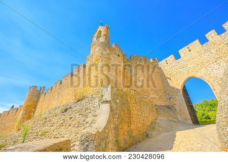 Tomar Fortress: Ancient Ruins Of Walls And Sun Door In Tomar, Portugal, Unesco Heritage. Tomar Conve