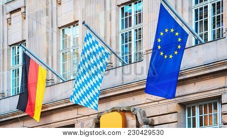 Bavarian Flag, Eu And German Flags At A Building In Berlin, Germany