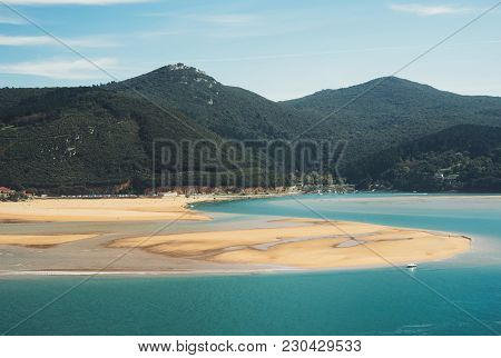 Observation Deck In Trip Holiday In Northern Spain, Top View On Seascape On Green Mountain And Sand