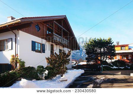 Residential Building At Garmisch-partenkirchen With Bright Green Shutters And Beautiful Facade Paint