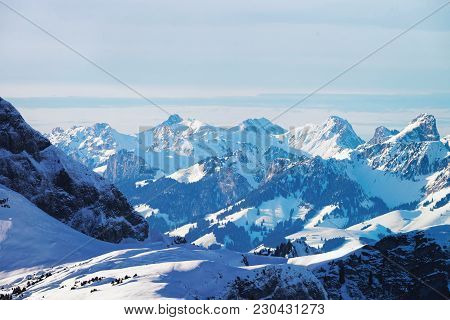 Bernese Oberland In Winter Swiss Alps, Helicopter View.