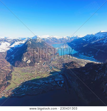 The Center Of Bernese Apline City Of Interlaken At Winter Swiss Alps, Helicopter View. Thun Lake And