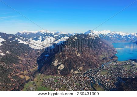 The Center Of Bernese Apline City Of Interlaken At Winter Swiss Alps, Helicopter View. Brienz Lake O