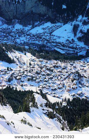 Aerial View On Wengen Village And Lauterbrunnen Town In Bernese Oberland In Switzerland.