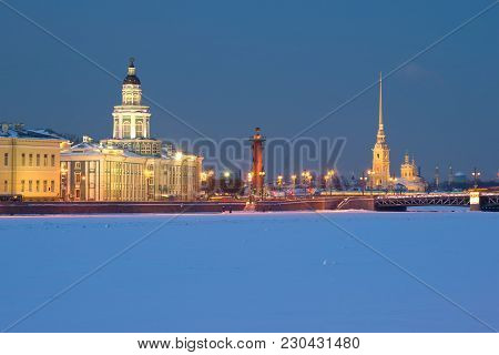 Rostral Column And Peter And Paul Cathedral In February Twilight. Saint-petersburg, Russia